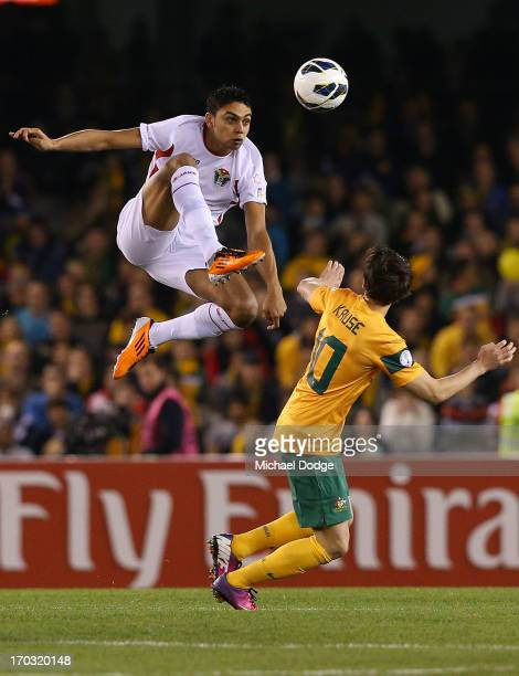 Saeed Murjan of Jordan and Robbie Kruse of the Socceroos contest for the ball during the FIFA World Cup Qualifier match between the Australian...