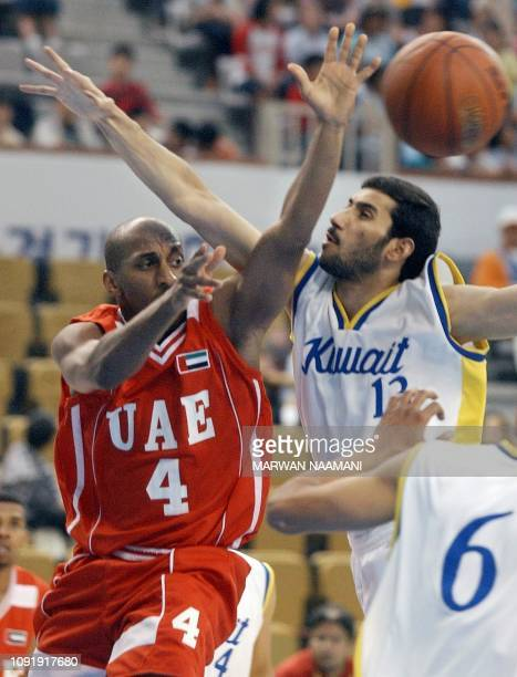 Saeed Salem Hamada of the United Arab Emirates sends an assist under the pressure of Hamad alShemmari during the two countries basketball game at...