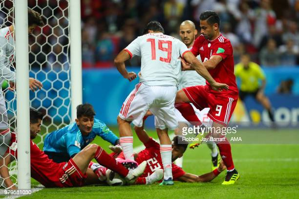 Saeid Ezatolahi and Ramin Rezaeian of IR Iran defend against Diego Costa of Spain during the 2018 FIFA World Cup Russia group B match between Iran...