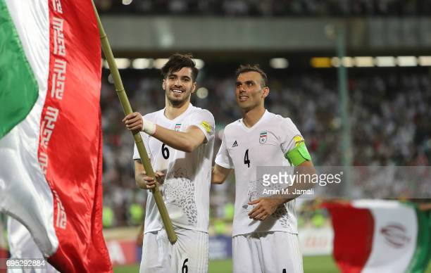 Saeid Ezatolahi and Seyed Jalal Hosseini of Iran celebrate after the match during FIFA 2018 World Cup Qualifier match between Iran and Uzbekistan at...