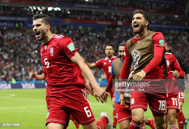 Saeid Ezatolahi of Iran celebrates after scoring his team's first goal which is then ruled offside and disallowed during the 2018 FIFA World Cup...