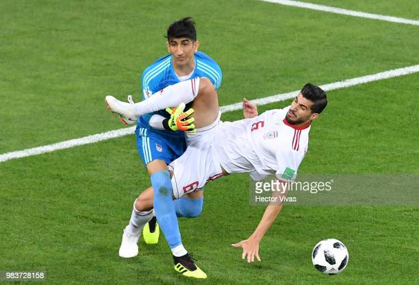 Saeid Ezatolahi of Iran collides with teammate Ali Beiranvand of Iran during the 2018 FIFA World Cup Russia group B match between Iran and Portugal...
