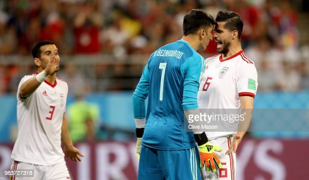Saeid Ezatolahi of Iran encourages teammate Ali Beiranvand during the 2018 FIFA World Cup Russia group B match between Iran and Portugal at Mordovia...