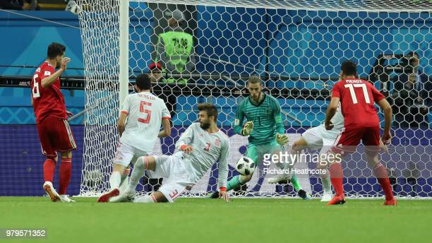 Saeid Ezatolahi of Iran scores a goal that will be disallowed due to offside during the 2018 FIFA World Cup Russia group B match between Iran and...