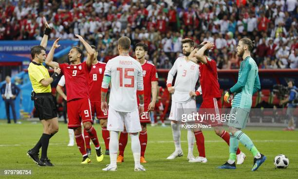 Saeid Ezatolahi reacts after his potential equalizer was ruled offside by the video assistant referee during the second half of a World Cup Group B...
