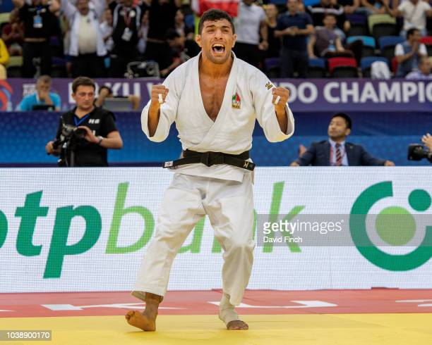 Saeid Mollaei of Iran screams with joy after throwing Sotaro Fujiwara of Japan for an ippon to win the u81kg gold medal during day four of the 2018...