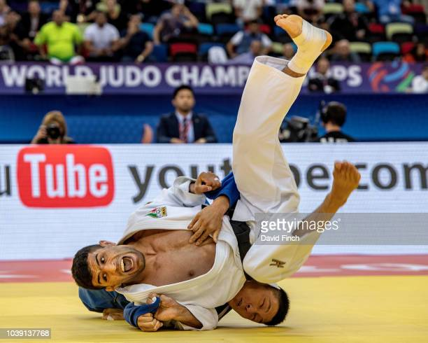 Saeid Mollaei of Iran throws Sotaro Fujiwara of Japan without a score during day four of the 2018 Judo World Championships at the National Gymnastics...
