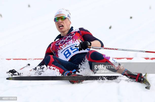 Saevar Birgisson of Iceland collapses in the ice after competing in the Men's 15 km Classic during day seven of the Sochi 2014 Winter Olympics at...