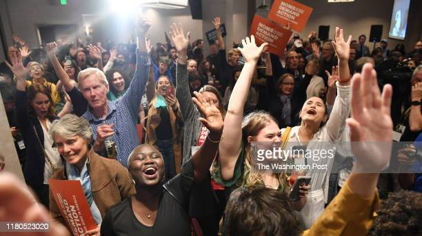 Safa Eltaib center left cheers with others at a Democratic election watch party at Hilton Richmond Downtown on Tuesday November 05 2019 in Richmond...