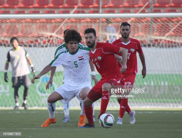 Safa Hadi of Iraq in action against Shadi Shaban of Palestine during a friendly match between Palestine and Iraq at the Faisal AlHusseini...