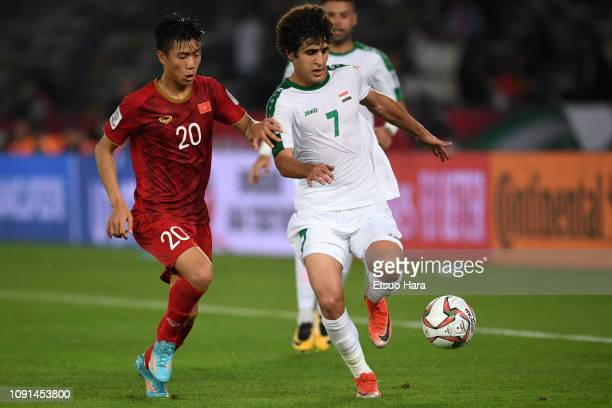 Safaa Hadi AlFuraiji of Iraq and Phan Van Duc of Vietnam compete for the ball during the AFC Asian Cup Group D match between Iraq and Vietnam at...