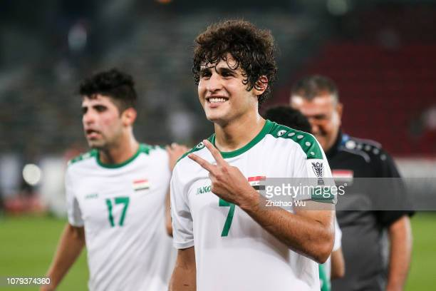 Safaa Hadi AlFuraiji of Iraq celebrates the victory with fans after the AFC Asian Cup Group D match between Iraq and Vietnam at Zayed Sports City...