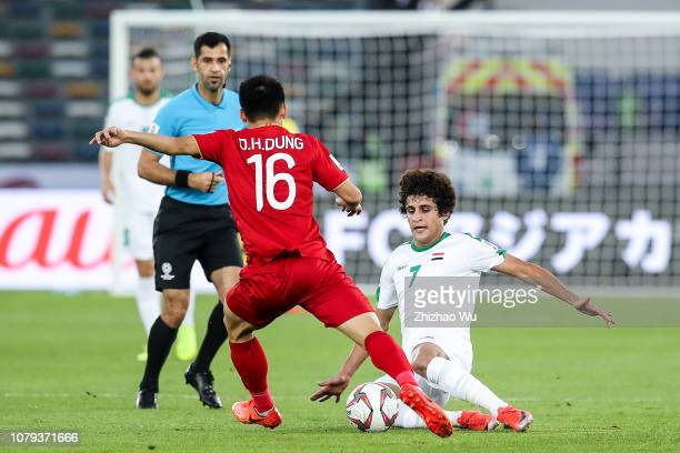 Safaa Hadi AlFuraiji of Iraq competes with Do Hung Dung of Vietnam during the AFC Asian Cup Group D match between Iraq and Vietnam at Zayed Sports...
