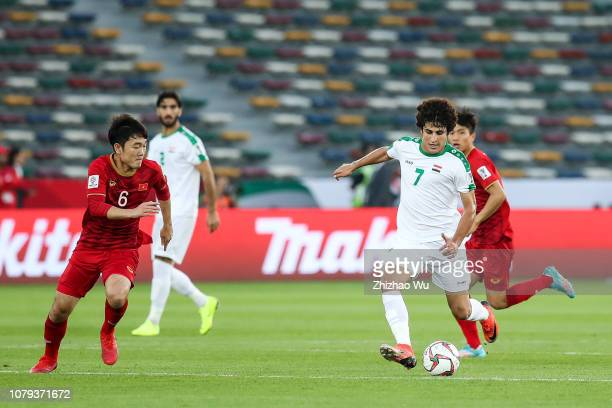Safaa Hadi AlFuraiji of Iraq competes with Luong Xuan Truong of Vietnam during the AFC Asian Cup Group D match between Iraq and Vietnam at Zayed...