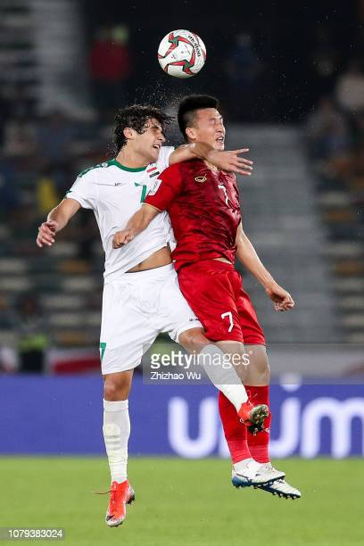 Safaa Hadi AlFuraiji of Iraq competes with Nguyen Huy Hung of Vietnam during the AFC Asian Cup Group D match between Iraq and Vietnam at Zayed Sports...