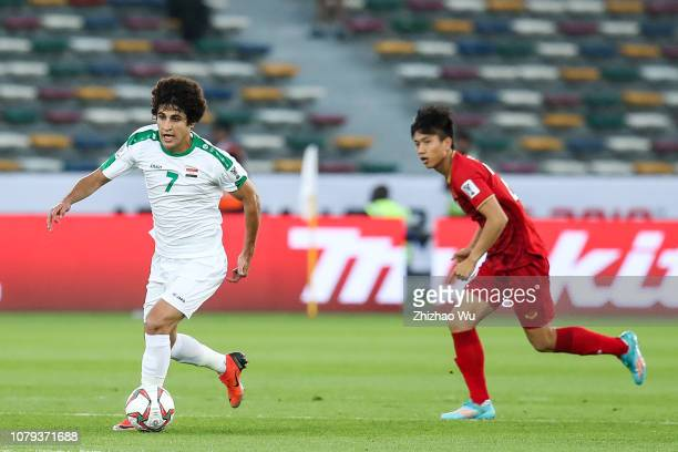 Safaa Hadi AlFuraiji of Iraq competes with Phan Van Duc of Vietnam during the AFC Asian Cup Group D match between Iraq and Vietnam at Zayed Sports...