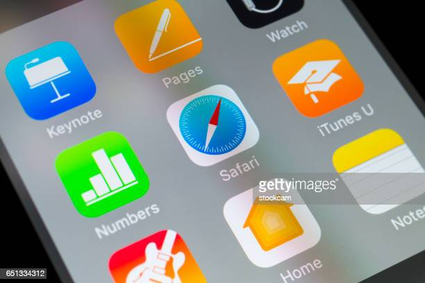 safari, numbers, itunes u and other apple apps on cellphone - home icon stock photos and pictures