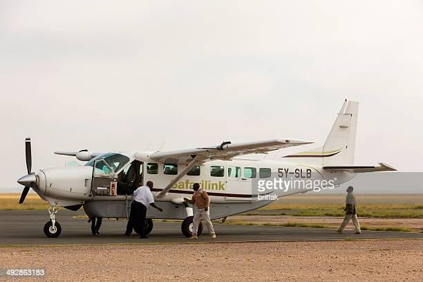 safari plane on airstrip in amboseli game reserve, kenya. - amboseli stock photos and pictures