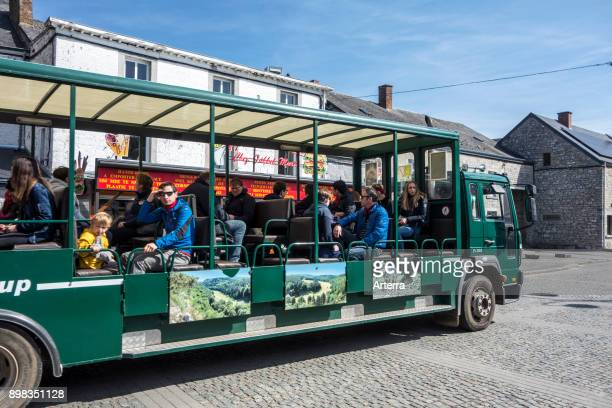 Safari train taking visitors to the wildlife park in the Domain of the Caves of Han through the village HansurLesse Belgian Ardennes Belgium