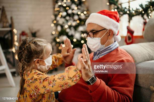 safe and happy for christmas - coronavirus winter stock pictures, royalty-free photos & images