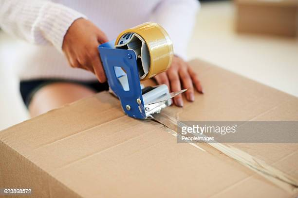 safe and sealed - tape dispenser stock photos and pictures