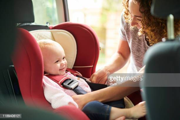 safe and secure in her car seat - red belt stock pictures, royalty-free photos & images