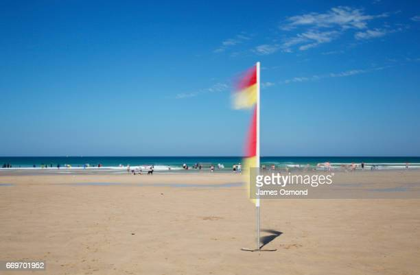safe bathing at the seaside. - cornish flag stock pictures, royalty-free photos & images