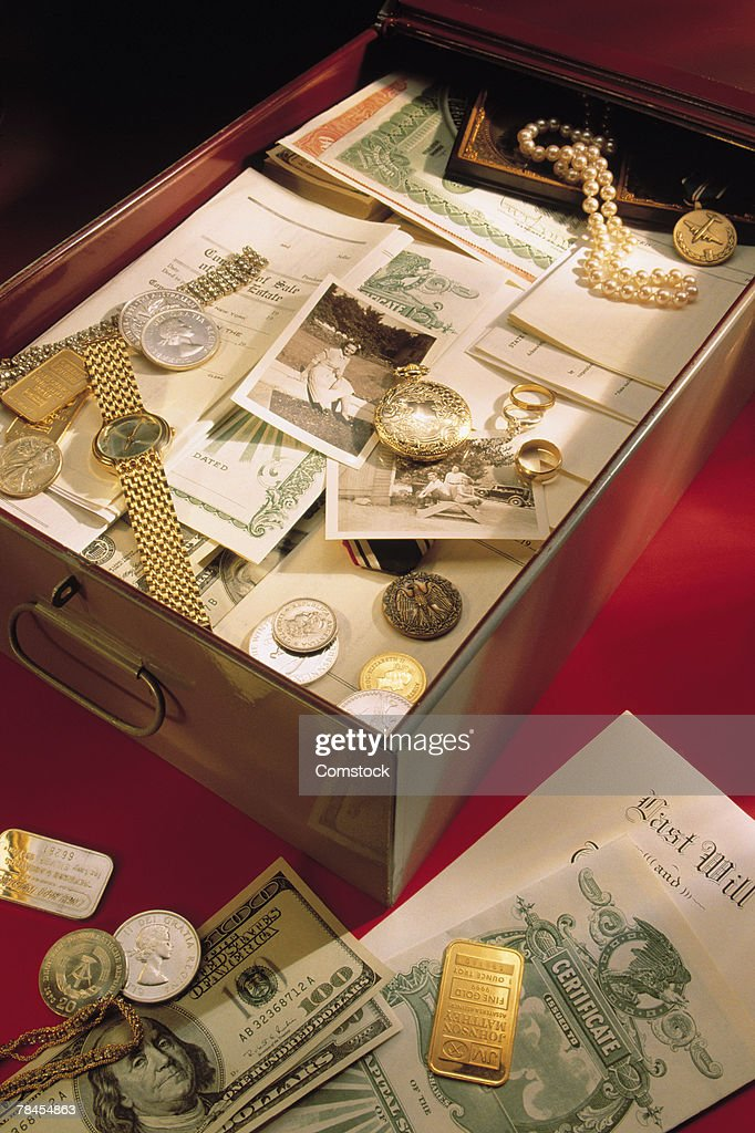 Safe deposit box filled with valuables : Stock Photo
