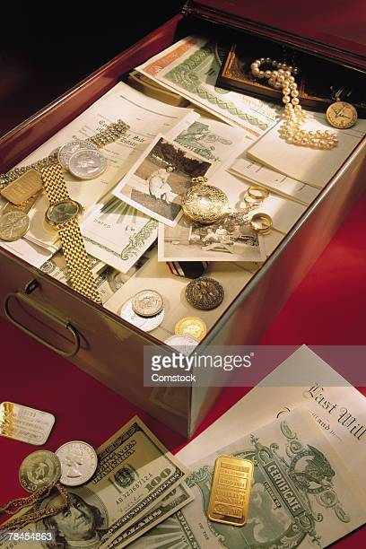 safe deposit box filled with valuables - safety deposit box stock pictures, royalty-free photos & images