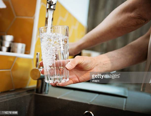 safe drinking tap water - drinking glass stock pictures, royalty-free photos & images