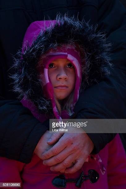 Safe in her fathers arms…Rich Demers holds his daughter Anahya from Meriden CT as they join other members of the public paying their respects at the...