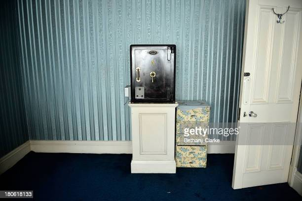 A safe is seen in one of the dressing rooms in Pineheath house on September 4 2013 in Harrogate England The untouched 40bedroom house belonged to...