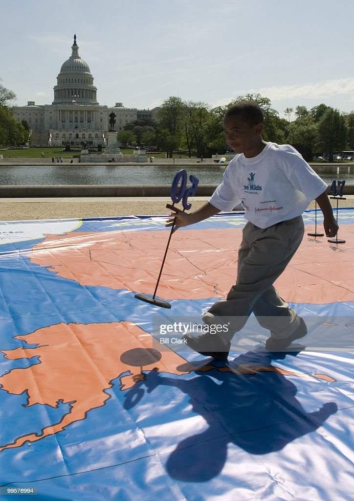 Safe Kids Worldwide used a giant map of the United States to illustate the state rankings of lowest accidental injury death rates during their news conference at the Capitol Reflecting Pool on Monday, April 30, 2007. An unidentified boy is shown placing the '50' marker on the state of Alaska. Wyoming was ranked worst at 51. DC was ranked 3rd best in the country.