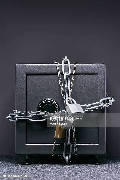Safe wrapped in chains and padlocks, close-up