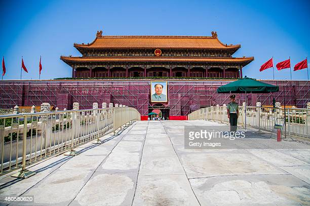 A safeguard stands in front of Tian'anmen Rostrum which is in painting and maintenance to welcome the 70th anniversary of the victory of AntiJapanese...