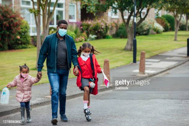 safely travelling back from school - school child stock pictures, royalty-free photos & images
