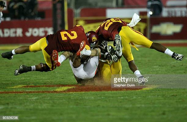 Safeties Taylor Mays and Will Harris of the USC Trojans tackle Casey Kjos of the Oregon State Beavers on October 24 2009 at the Los Angeles Coliseum...