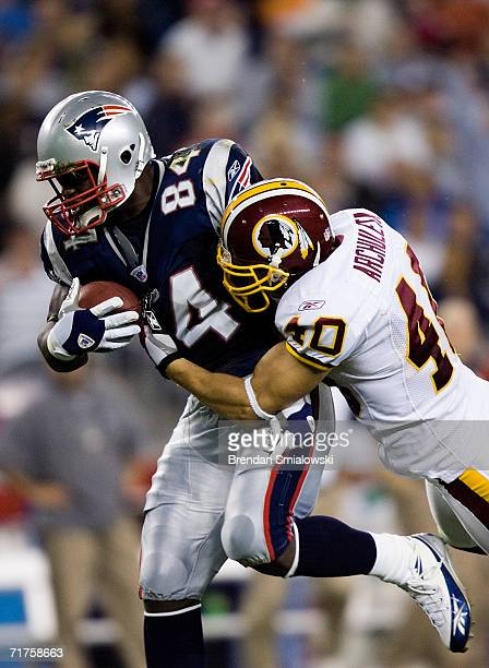 Safety Adam Archuleta of the Washington Redskins tackles tight end Benjamin Watson of the New England Patriots during a preseason game at Gillette...