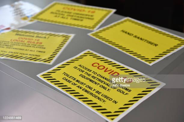 Safety and warning signs are displayed in the office as golf courses reopen in England under government guidelines during the Coronavirus pandemic at...