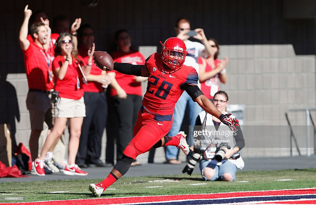 Safety Anthony Lopez #28 of the Arizona Wildcats scores a 25 yard touchdown on a fumble recovery in the first quarter of the Territorial Cup college football game against the Arizona State Sun Devils at Arizona Stadium on November 28, 2014 in Tucson, Arizona.