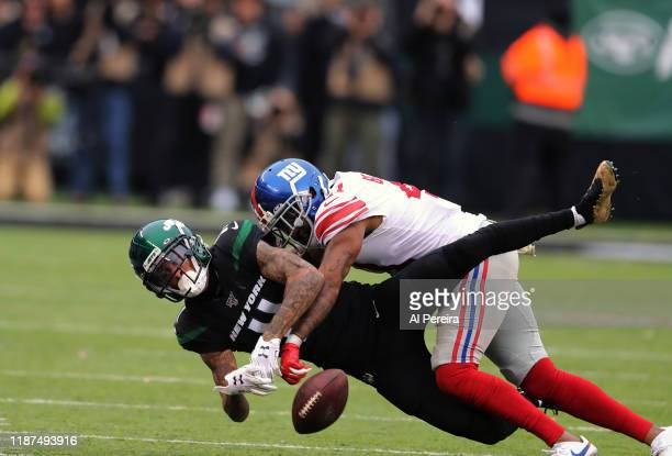 Safety Antoine Bethea of the New York Giants breaks up a pass to Wide Receiver Robby Anderson of the New York Jets in the second half at MetLife...