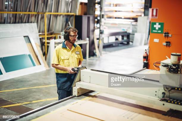 Safety at work - Australian employee with protective eyewear and headphones
