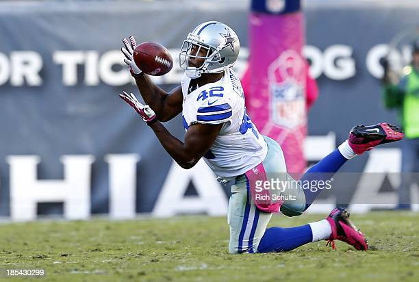 Safety Barry Church of the Dallas Cowboys intercepts a pass by quarterback Matt Barkley of the Philadelphia Eagles in the fourth quarter during a...