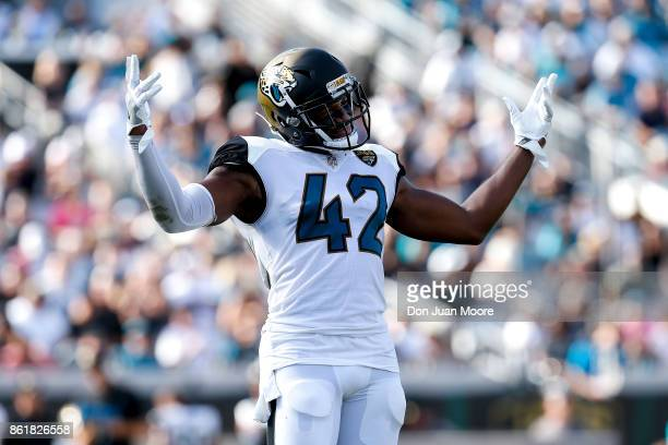 Safety Barry Church of the Jacksonville Jaguars celebrates after a play during the game against the Los Angeles Rams at EverBank Field on October 15...