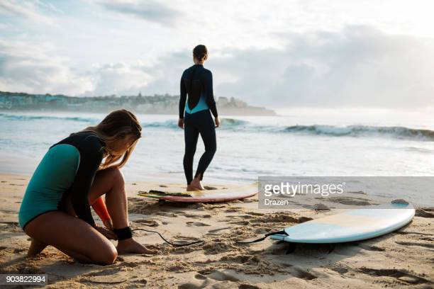 safety before the surfing in waving ocean - calm before the storm stock pictures, royalty-free photos & images