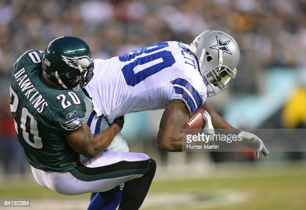Safety Brian Dawkins of the Philadelphia Eagles tackles tight end Martellus Bennett of the Dallas Cowboys during a game on December 28 2008 at...