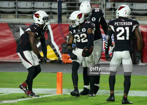 Safety Budda Baker of the Arizona Cardinals celebrates with teammates after Baker returned a 90-yard interception to the Seattle Seahawks 8-yard line...