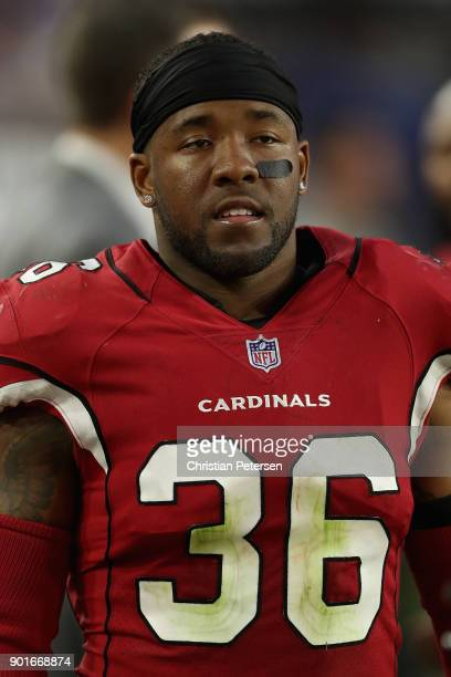 Safety Budda Baker of the Arizona Cardinals on the bench during the second half of the NFL game against the New York Giants at the University of...