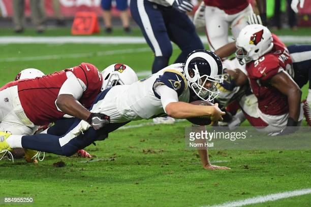Safety Budda Baker of the Arizona Cardinals tackles quarterback Jared Goff of the Los Angeles Rams during the first half of the NFL game at the...
