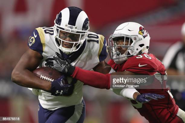 Safety Budda Baker of the Arizona Cardinals tackles wide receiver Pharoh Cooper of the Los Angeles Rams during the second half of the NFL game at the...